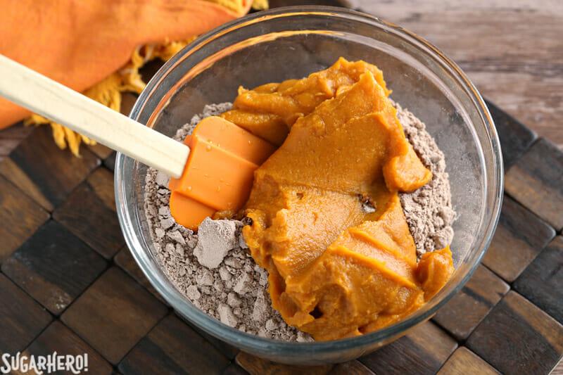 2-Ingredient Pumpkin Brownies - mixing pumpkin puree and brownie mix together | From SugarHero.com