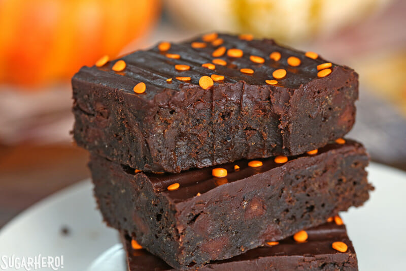 2-Ingredient Pumpkin Brownies - close-up of pumpkin brownies with a bite taken out | From SugarHero.com