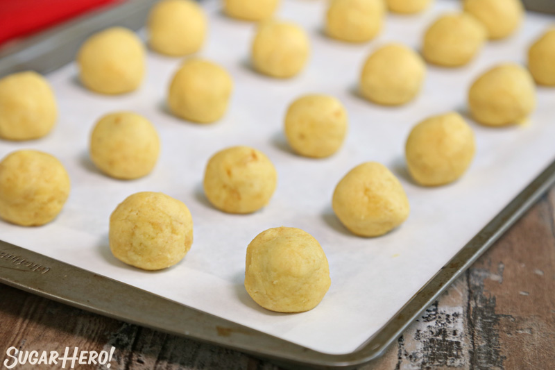 Bloody Truffles - a sheet tray of round cake truffles on parchment paper | From SugarHero.com