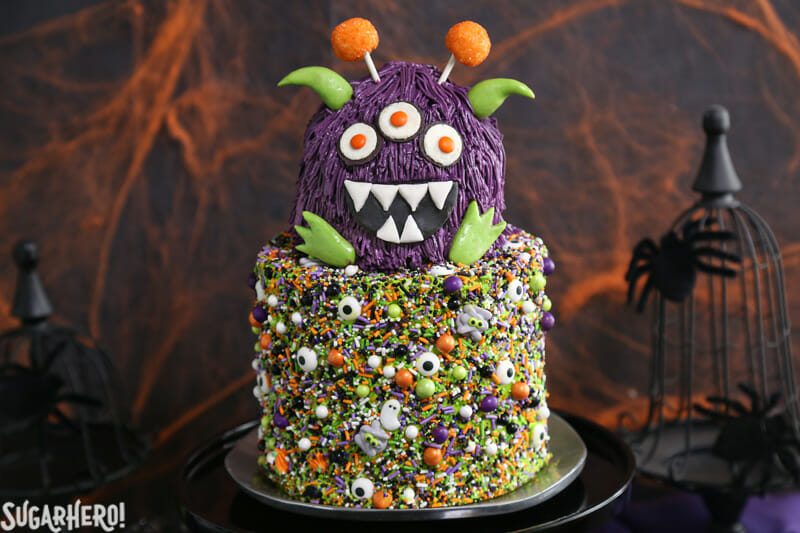Monster Cake - two-layer Halloween cake with a monster on top | From SugarHero.com