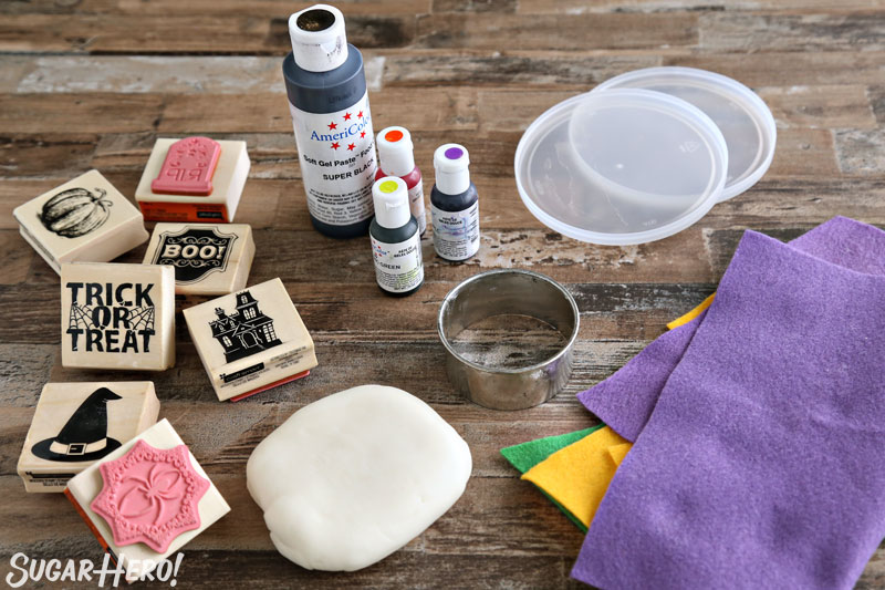 Stamped Halloween Cupcakes - ingredients needed to make stamped fondant circles, including fondant, food coloring, stamps, and felt | From SugarHero.com