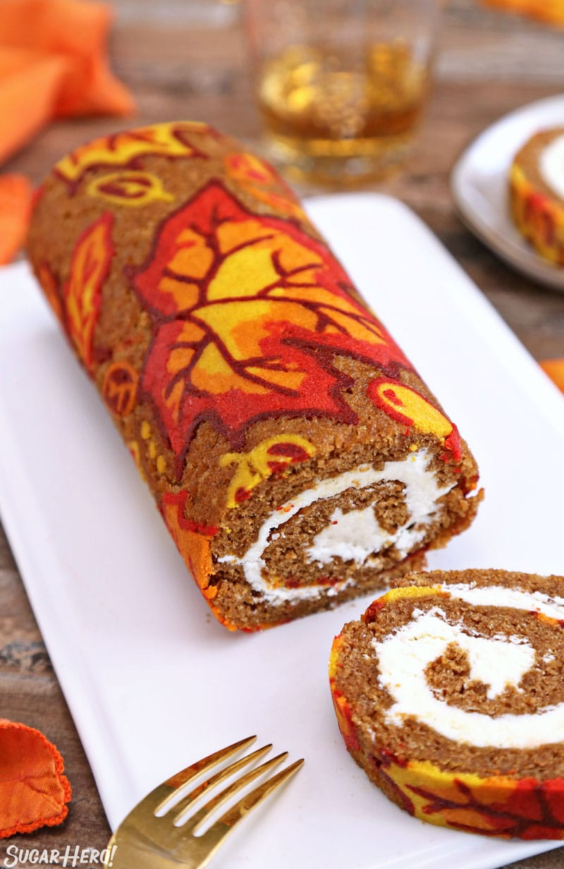 Patterned Pumpkin Roll - A shot of the pumpkin roll with a slice cut from it. | From SugarHero.com