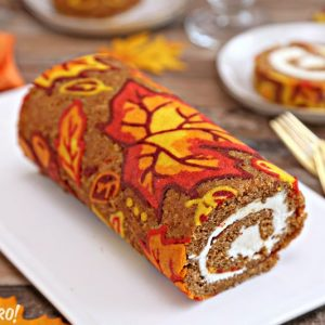 Patterned Pumpkin Roll on a white platter