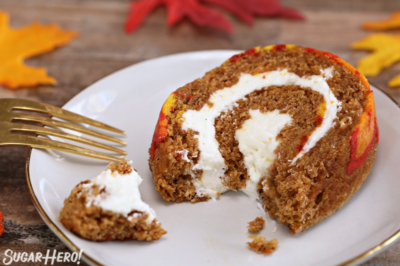 Patterned Pumpkin Roll - a slice of the pumpkin roll with a bite taken out of it. | From SugarHero.com