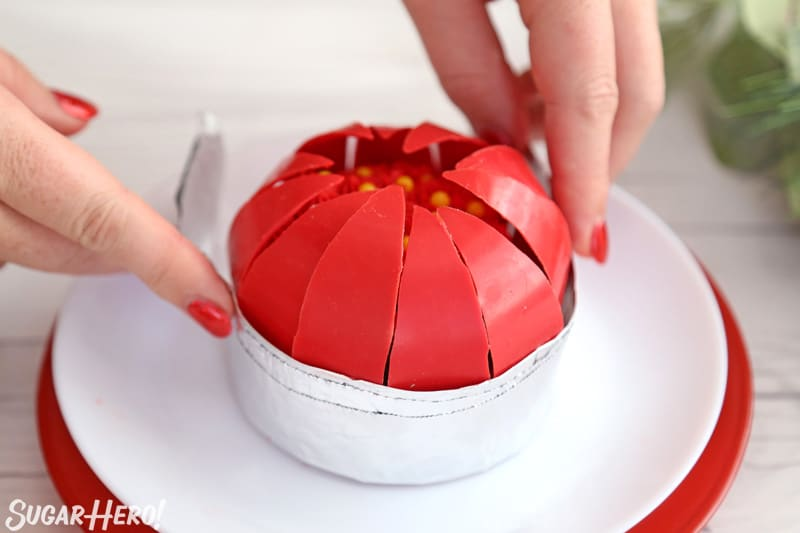Blooming Chocolate Flowers - using a foil collar to create a sphere of red chocolate petals   From SugarHero.com