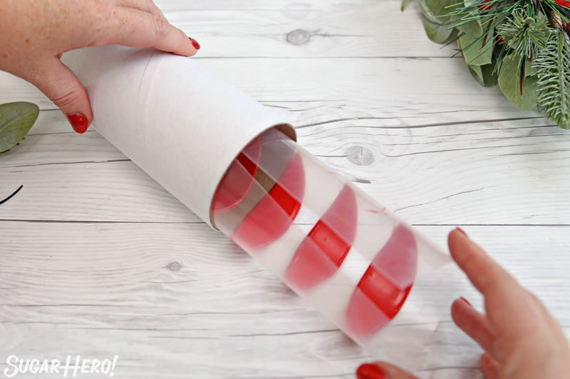 Blooming Chocolate Flowers - rolling up chocolate petals into a cardboard tube to create perfectly curved petals | From SugarHero.com