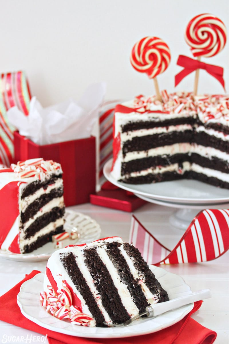 Candy Cane Chocolate Cake - cake cut open with two slices of cake next to it | From SugarHero.com