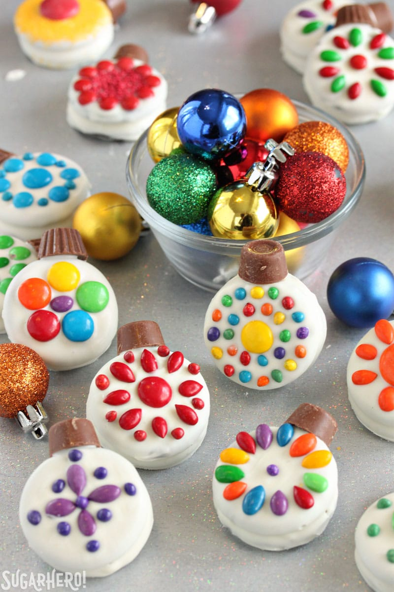 Oreo Cookie Christmas Ornaments - group of Christmas cookies arranged around a bowl of colorful ornaments | From SugarHero.com