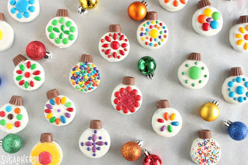 Oreo Cookie Christmas Ornaments - bright and colorful cookies scattered with ornaments around | From SugarHero.com