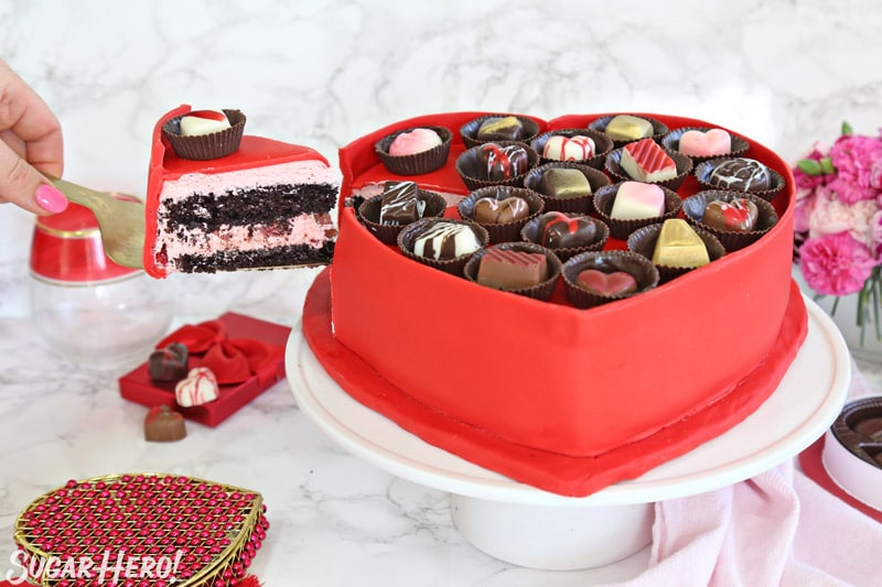 Box of Chocolates Cake - removing a slice of cake with a gold cake server | From SugarHero.com