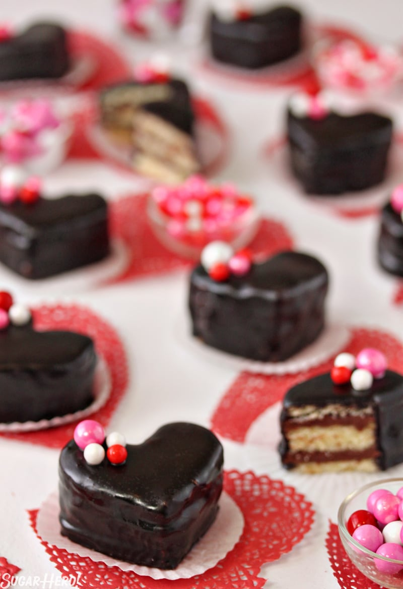 Nutella Pound Cake Petit Fours - Nutella heart shaped cakes with bowls of candy in between. | From SugarHero.com