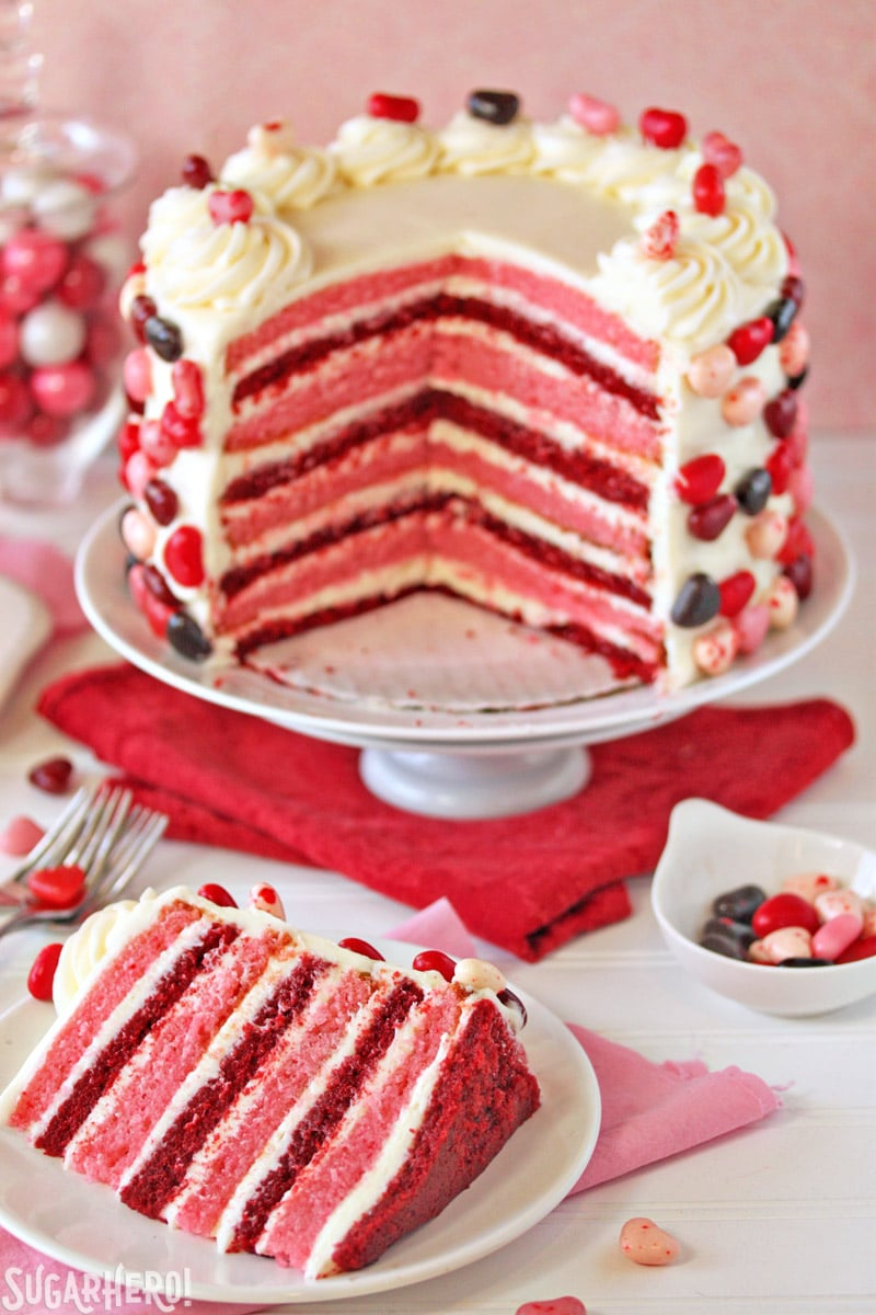 Sky-High Pink and Red Velvet Cake - Cake cut open displaying pink and red stripes throughout layers of cake. | From SugarHero.com