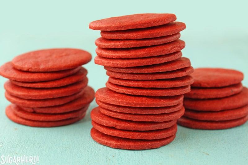 Red Icebox Cakes - three separate stacks of Red Velvet cookies to make Red Velvet Icebox Cakes | From SugarHero.com