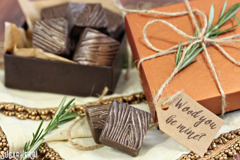 "Rosemary Raspberry Truffles - square chocolate truffles with a wood grain pattern, in a decorative candy box with a ""Wood you be mind?"" tag 
