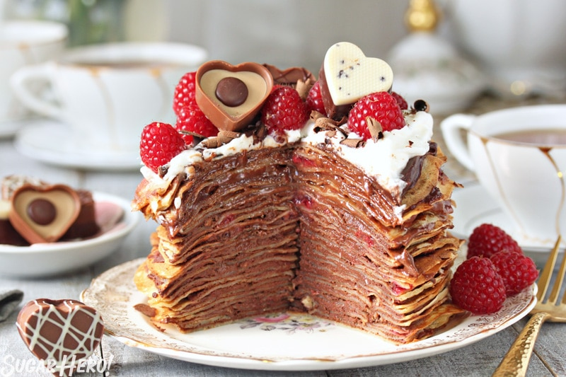 Chocolate Raspberry Mini Crepe Cakes - A crepe cake with a slice taken out. | From SugarHero.com
