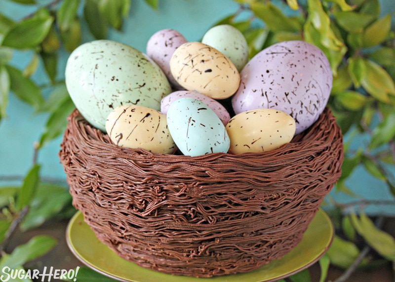 Easter Nest Cake - A picture of the cake displaying the eggs inside the nest cake. | From SugarHero.com