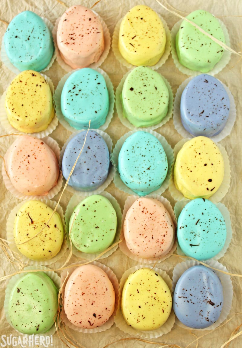 Easter Egg Petit Fours - vertical shot of pastel petit fours lined up in a grid | From SugarHero.com