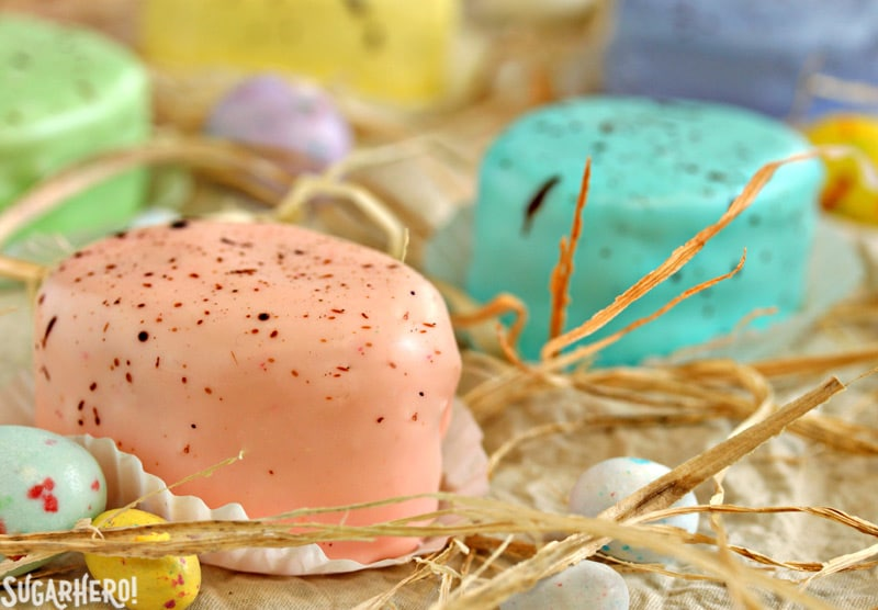 Easter Egg Petit Fours - close-up of speckled pink petit four | From SugarHero.com