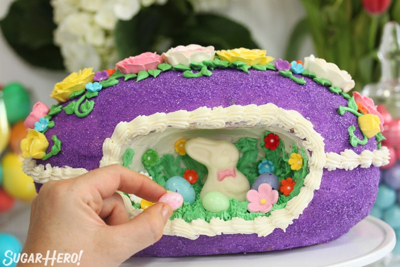 Placing a jelly bean in the middle of a sugar Easter egg cake