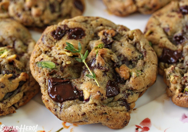Clemen-Thyme Chocolate Chunk Cookies - Straight shot of a cookie with the chocolate chunks and thyme on top.   From SugarHero.com