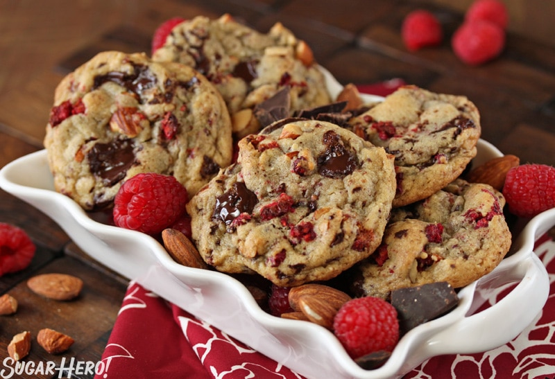 Raspberry Almond Chocolate Chunk Cookies - A shot of the cookies displayed in a platter. | From SugarHero.com