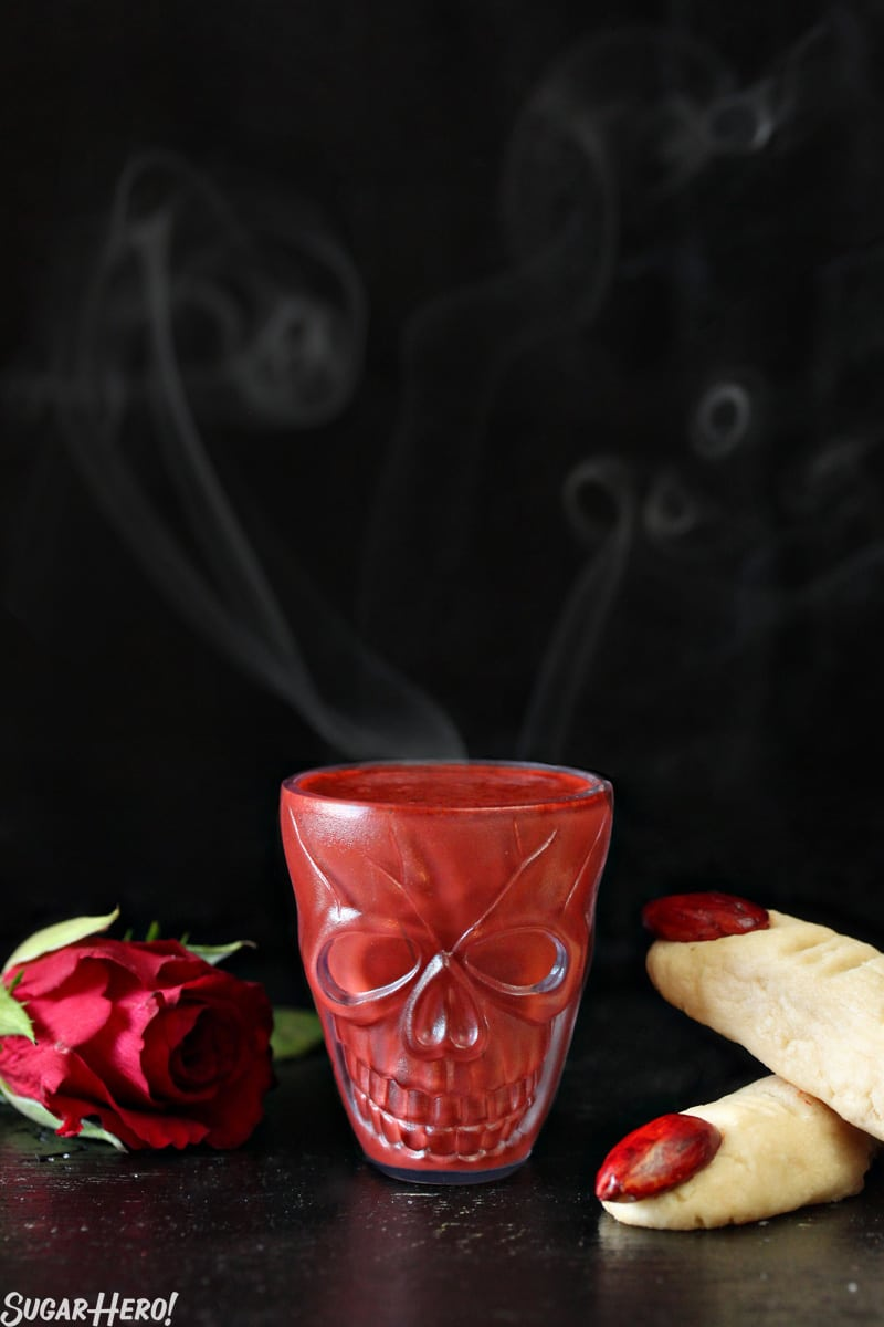 This Red Velvet Hot Chocolate - A straight shot of the hot chocolate in a skull shot glass. | From SugarHero.com