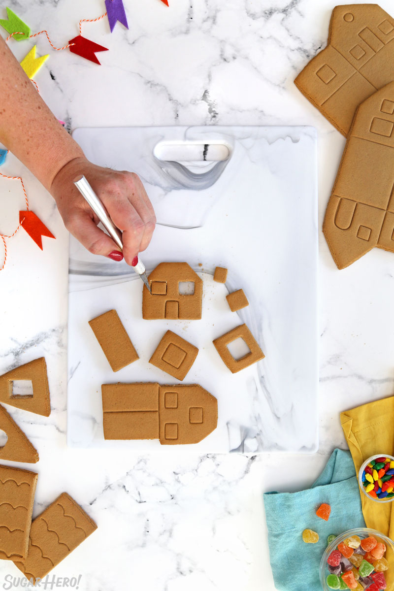 Process shot showing cutting apart the gingerbread house pieces