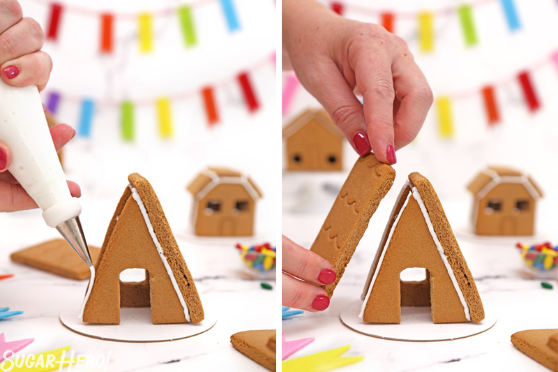 Process shot showing piecing together the gingerbread houses and gluing them with royal icing