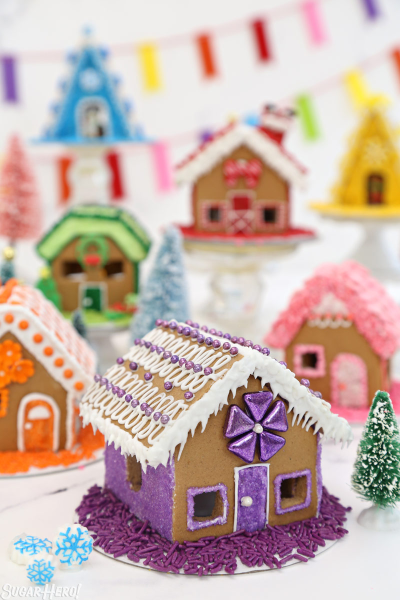 Miniature gingerbread houses decorated with rainbow colors   From SugarHero.com