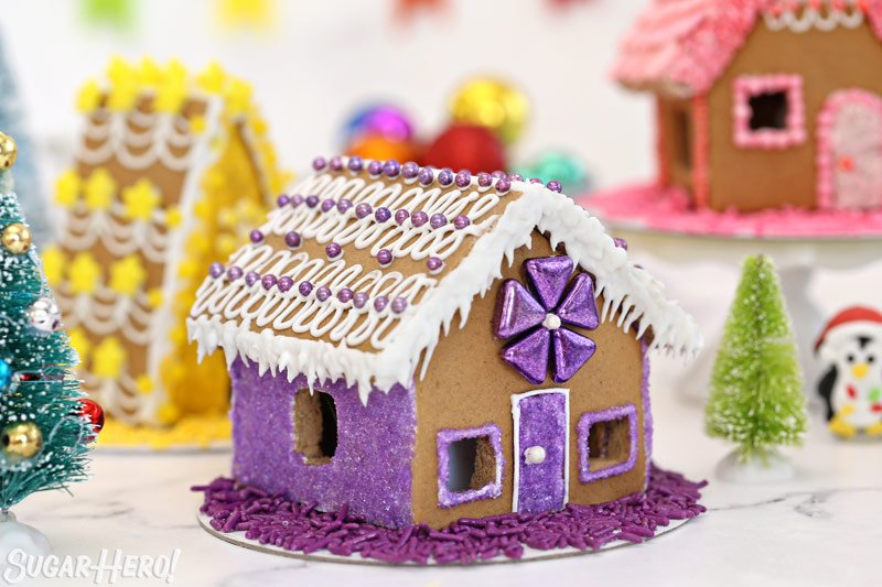 Purple-themed gingerbread house, with purple metallic decorations
