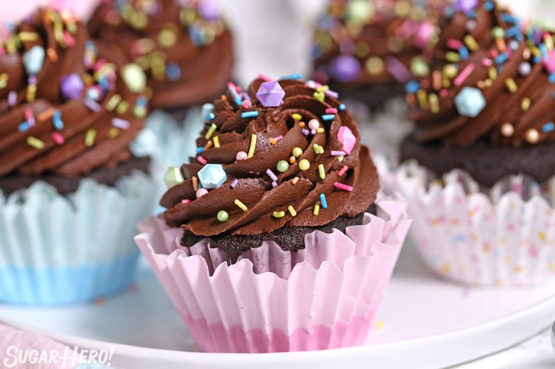 Close-up of moist chocolate cupcake with chocolate frosting and sprinkles on top