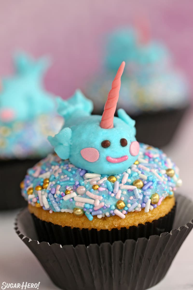 Sprinkle cupcakes with a piped buttercream narwhal on top