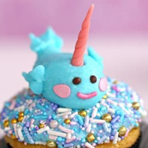 Close-up of buttercream narwhal cupcake