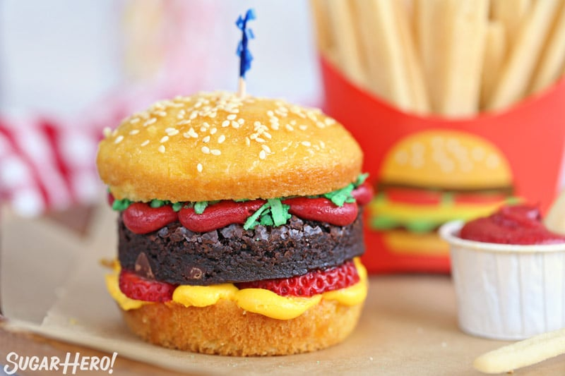 Hamburger cupcake with sesame seeds on top, and sugar cookie french fries in the background