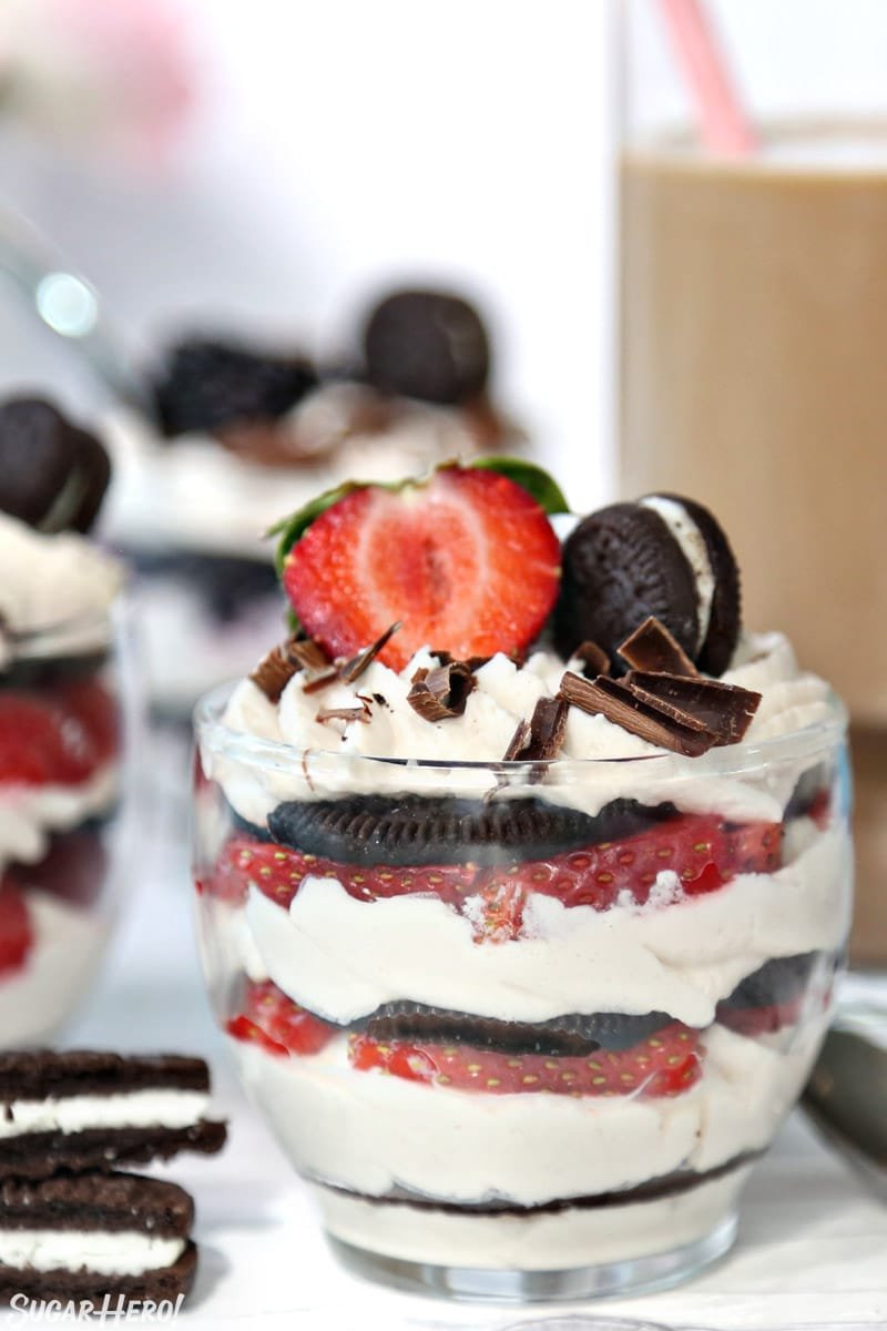 Mini oreo icebox cake with a glass of iced coffee behind it