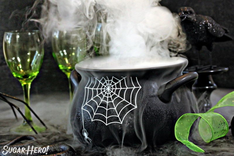 Bubbling cauldron with smoke coming out of the top