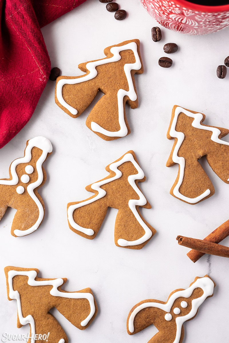 Gingerbread Cookie Mug Toppers on a white tabletop with a red napkin in the corner