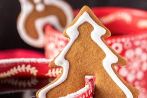Tree-shaped Gingerbread Cookie Mug Topper on a red mug with overlay text for Pinterest