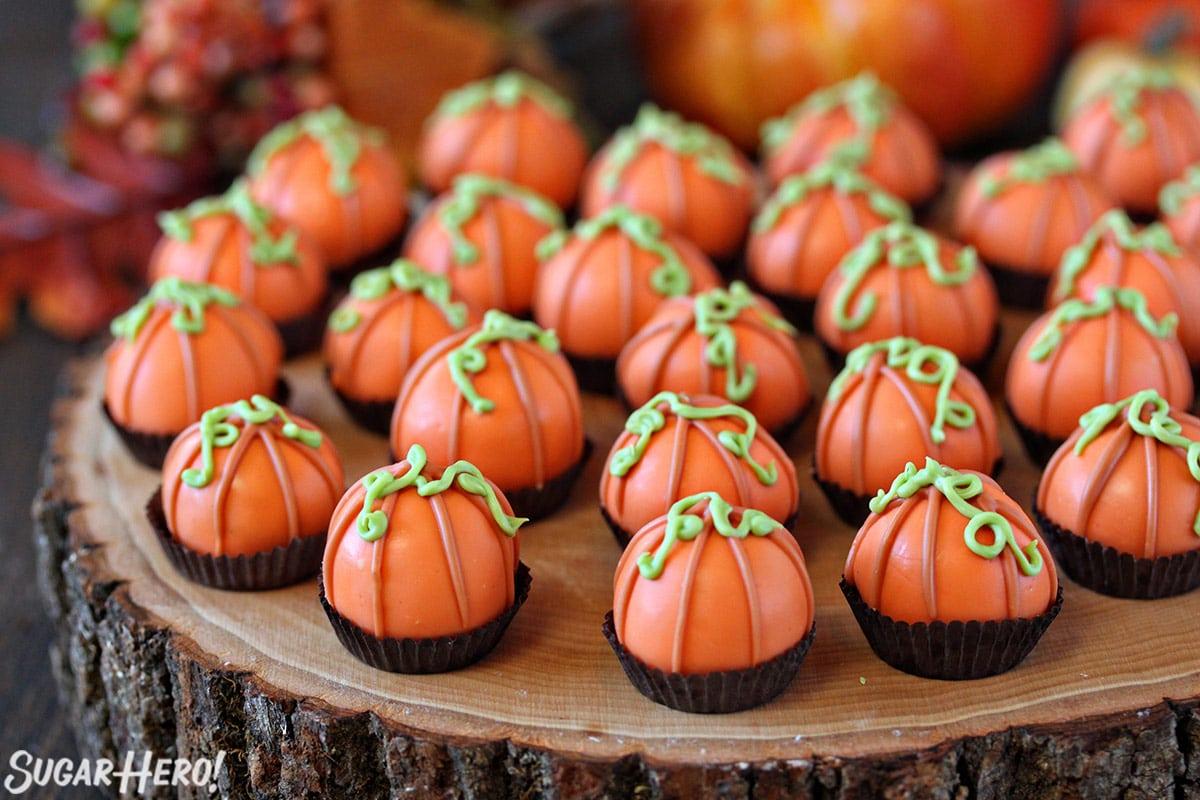 Group of Pumpkin Bread Truffles decorated to look like mini pumpkins