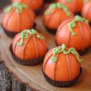 Close-up of Pumpkin Bread Truffles on wooden plate