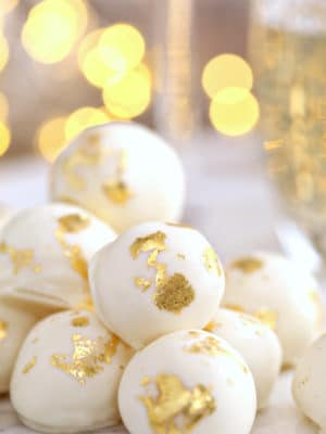 Close-up of Champagne White Chocolate Truffles with gold leaf decorations