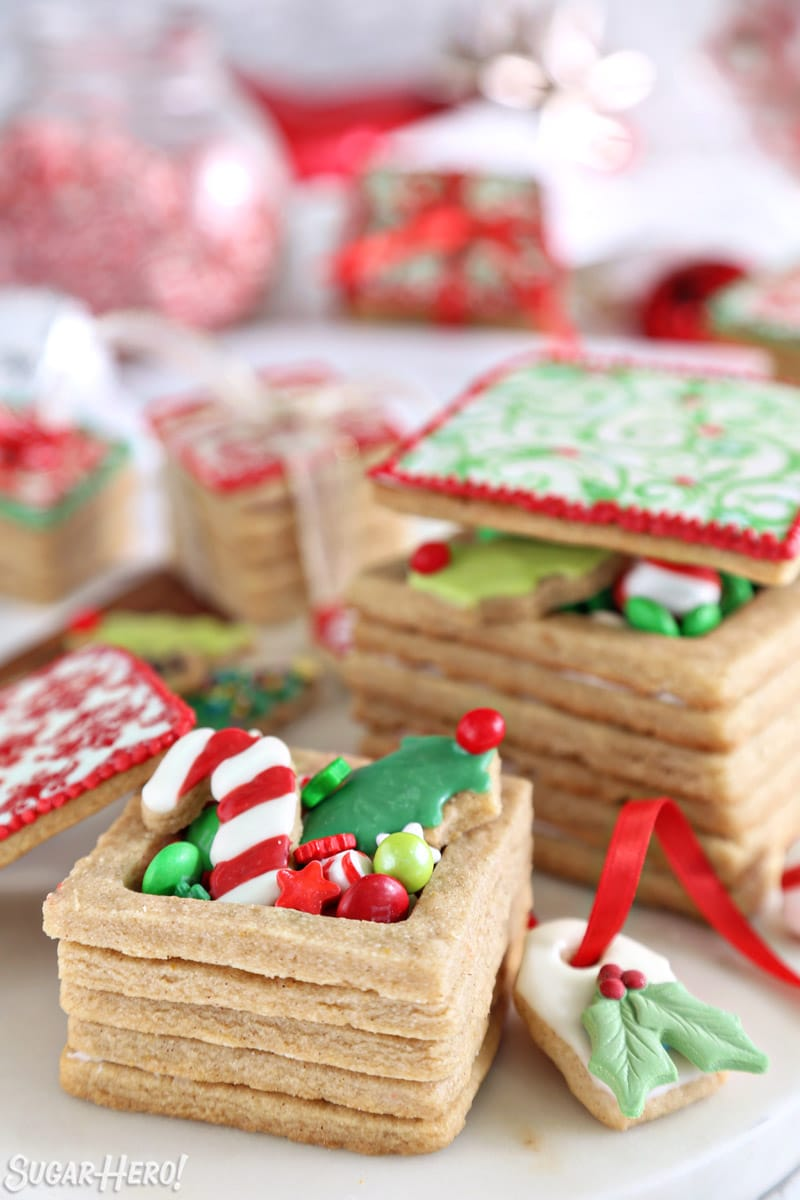 Edible Christmas Cookie Boxes with decorated cookies and candies peeking out the top