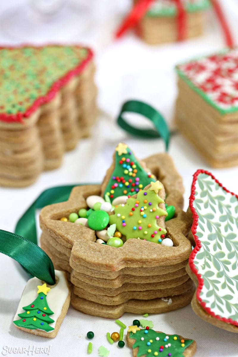 Christmas tree-shaped Edible Christmas Cookie Box with green cookies and candies inside