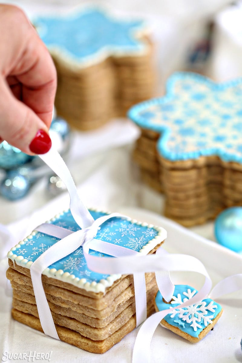 Blue Edible Christmas Cookie Box with white ribbon being wrapped around it