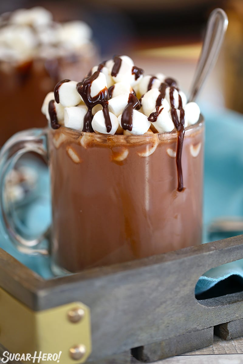 Slow Cooker Hot Chocolate in a glass mug with mini marshmallows and a chocolate drizzle