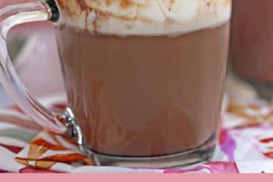 Slow Cooker Hot Chocolate topped with whipped cream, with text overlay for Pinterest