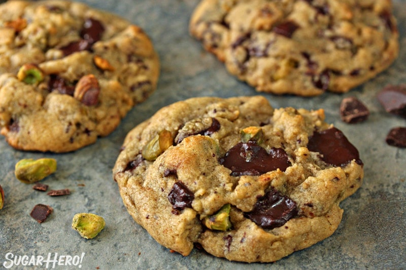 Close-up of Pistachio Chocolate Chunk Cookies on a blue tile