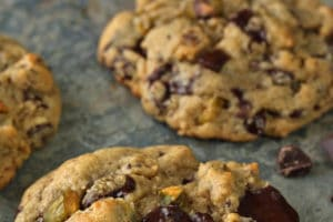 Close-up of Pistachio Chocolate Chunk Cookies with text overlay for Pinterest