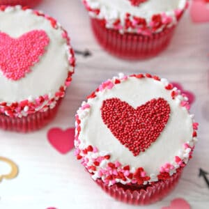 Close-up of cupcake with red heart-shaped sprinkle shape in the center