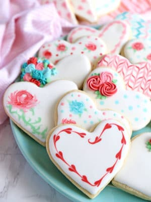 Blue plate of Valentine's Day sugar cookies decorated with royal icing